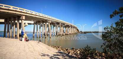 Blue sky over the bridge roadway that journeys onto Marco Island