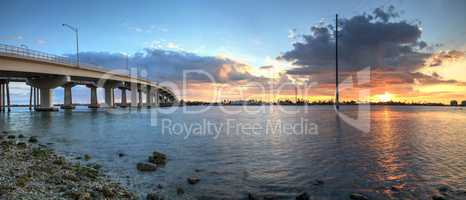 Sunset over the bridge roadway that journeys onto Marco Island,