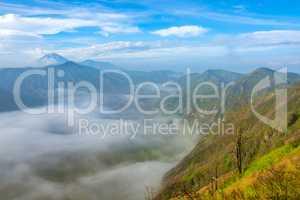 Morning Mist in the Valley between Volcanoes
