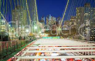 Brooklyn Bridge with car traffic at night