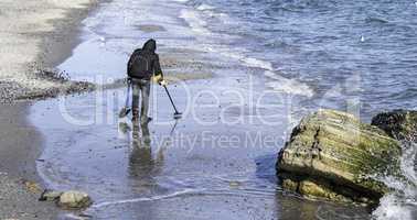 Treasure hunter on a beach