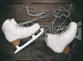 old white female skates for figure skating with unbound laces