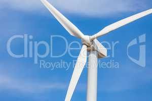 Single Wind Turbine Over Dramatic Blue Sky