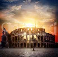 Colosseum and sunny sunrise