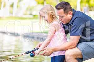 Young Caucasian Father and Daughter Having Fun Fishing At The La