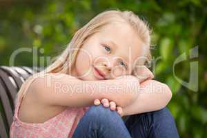 Pretty Young Caucasian Girl Portrait Sitting On The Bench At The