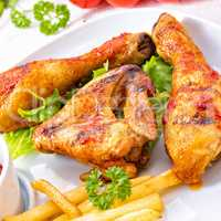 Grilled chicken wings,legs,chips and vegetables