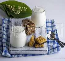 two jars with homemade yogurt and snacks from muesli