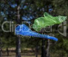 Two polyethylene bags for garbage fly in the air