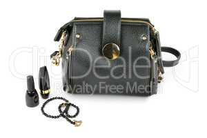 Bag, cosmetics and beads isolated on white background