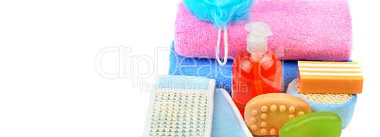 Cotton towels, cosmetic soap, sponge and shampoo isolated on whi