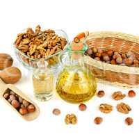 Oil of walnut and hazelnut, nut isolated on white .