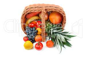 Vegetables and fruits in a basket isolated on white background.