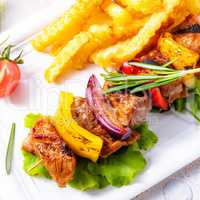shish kebab skewers with marinated ham meat paprika and red onio