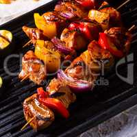 Rustic shish kebab skewers with marinated ham meat paprika and r