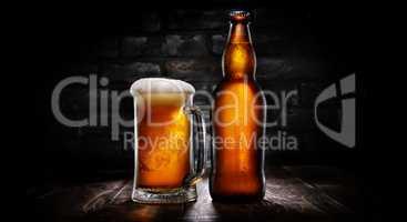 Beer in mug and bottle on black
