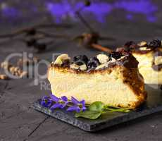 piece of cheesecake on a black background