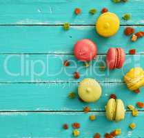Multicolored cake of almond flour with cream macarons
