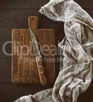 old brown wooden kitchen board with handle