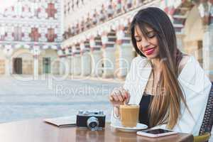 attractive happy woman having a coffee on a street. Lifestyle co