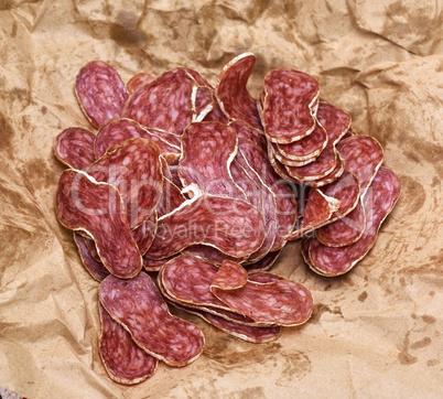 sliced salami on a brown paper