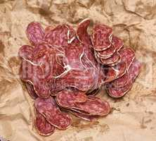sliced salami on a brown paper