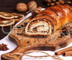 baked roll with cinnamon and nuts