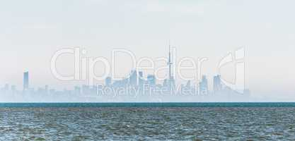 Foggy city skyline of Toronto on Lake Ontario.