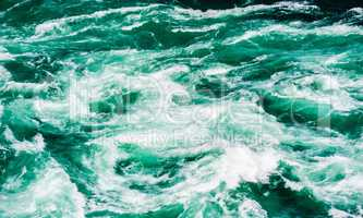 Abstract water currents and rapids in green river