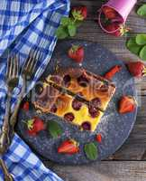 two pieces of cheesecake with strawberries