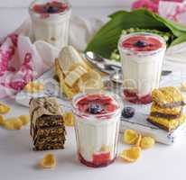 yogurt in transparent glass with syrup and banana