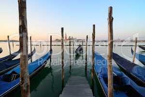Condolas and wooden pier