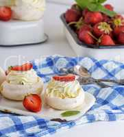 round baked meringue pie with strawberries