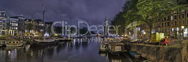 Panoramic View Of Amsterdam At Night At A Water Channel