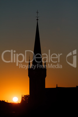 Beautiful Sunset Behind A Church Silhouette And Wonderful Colors