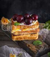 fried square pieces of white bread with soft curd and cherries