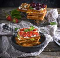 a pile of French toast from white bread with cottage cheese in a
