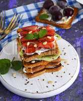 a pile of French toast with cottage cheese, strawberries, kiwi a