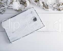 empty white wooden board, textile napkin