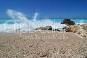 Splashing waves on empty beach