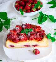 half cheesecake made of cottage cheese and fresh strawberries