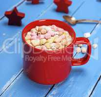 mug with hot chocolate and small pieces of marshmallow