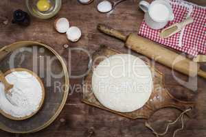 dough made from white wheat flour on a wooden board