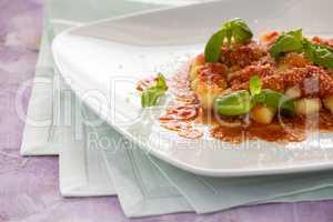 Gnocchi, Italian pasta with tomato sauce basil and parmesan chee