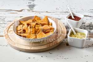 Nachos chips in a white bowl