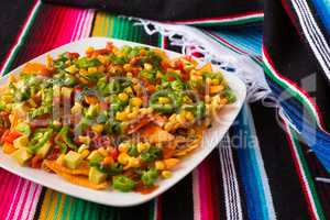 Nachos salad in a square plate