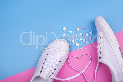 Fashion Trendy White Sneakers with Heart. Pastel Pink Blue Color. Candies. Valentines day concept