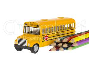 Yellow School bus and pencil in education isolated on white background