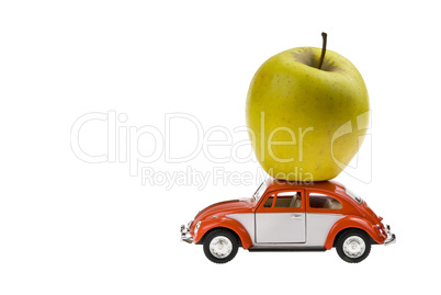 Green Yellow apple on the Beetle car model. Isolated on white background