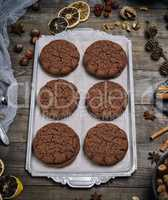 chocolate round biscuit on an iron plate